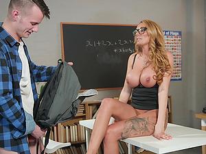 Naughty MILF teacher Stacey Saran fucked in the classroom and gets cum