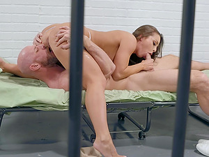 Horny inmate babe Abigail Mac rides a well hung guard in a prison cell