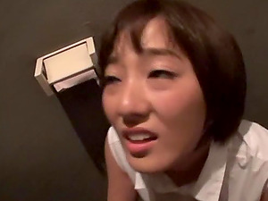 Short haired Japanese Sawamura Nagisa sucks dick in a public toilet