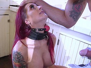 Submissive long haired inked Tana Lea strapped to a table and fucked