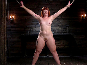 Chubby pale redhead Barbary Rose straped in bondage and tortured