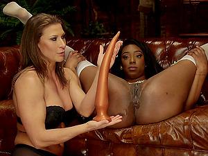 Lisa Tiffian and Ariel X enjoy dirty sex on the sofa using huge toys