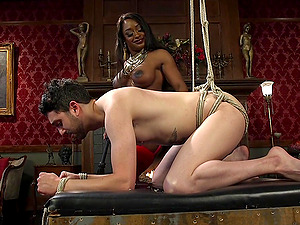 Adorable ebony Kelli Provocateur uses a strapon to fuck her horny friend