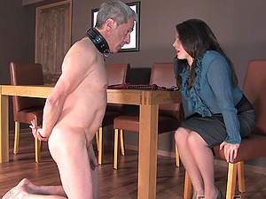 Mistress Lola spanks her slave and forces him to lick her feet
