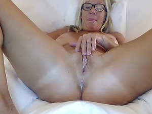 Busty milf fucks her creamy pussy with a dildo live