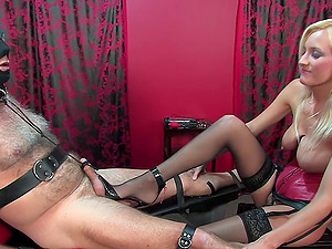 Helpless slave with a small dick gets penetrated by Mistress Autumn