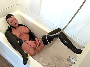 Costumed girl masturbates in the bath by the shower and a dildo