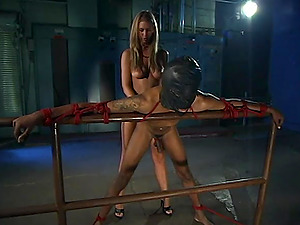 Secret Agent uses a strapon and dirty ideas to satisfy her tied friend