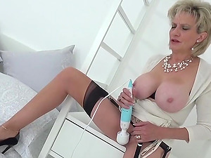 Lady Sonia undresses and plays with her toy