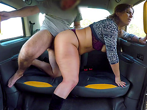 Horny milf screams from pleasure while a taxi driver fucks her badly