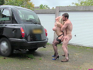 Blonde Rebecca More gets her cunt fucked by a handsome guy in the car