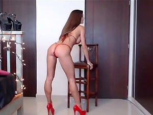 Horny babe fucking her red dildo on webcam and loves it
