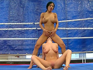Jessica Moore and Kyra Black hit each other and eat honeypots on a ring