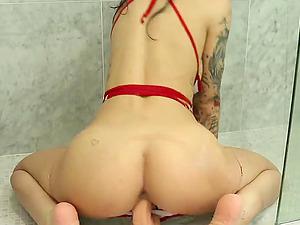 Tattooed nurse with beautiful boobs enjoy dildo in the shower