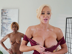 During the massage Nicolette Shea gets her cunt pleased by a lesbian