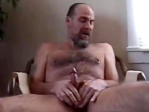 Hot hairy bear fingering a huge meaty cock in front of the camera