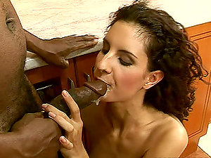 Hot black-haired Leanna Sweet luvs railing a Big black cock in the kitchen