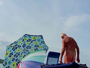 Another sexy hung straight grandpa at the nudist beach.