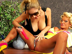 Mature chicks Carol Goldnerova and Sharon Pink playing with each other