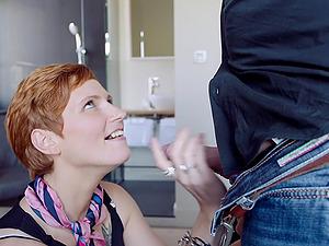Hot redhead Kimberly rides a big cock