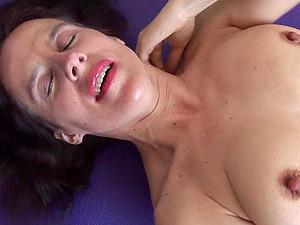 Solo mature amateur gets naked during her yoga session and masturbates