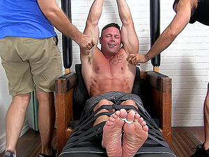 Tied up muscular guy moans from pleasure and begs them not to stop