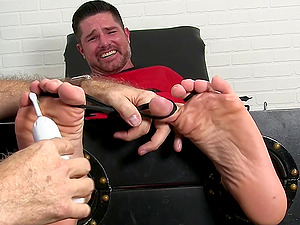 Brutal feet tickling and torture for a tied up dude. Amateur