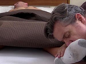 Mature pervert licks dirty socks and feet of a sleeping guy