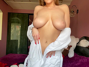 Home alone Josephine Jackson teases her webcam fans with her hooters