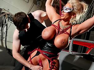 Erotic BDSM torture scene with massive hooters Alura Jenson