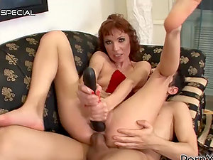 Nasty Ginger-haired Cougar Gets Dual Penetrated by Man rod and Fake penis