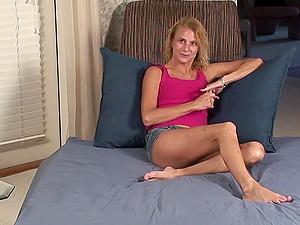 Skinny blonde milf Vanessa masturbates with a toy