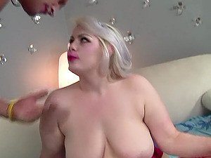 Gorgeous busty blonde BBW Klaudia Kelly is all dolled up in her sexy red lingerie