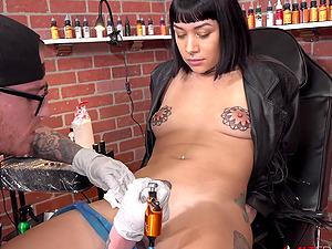 Selena gets a tattoo then sucks 2 cocks