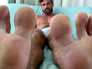 Dirty dude loves teasing with his socks and feet in an amateur video