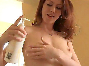 Sexy Sandy-haired Bitch Munching Her Natural Tits and Displaying Cootchie