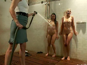 Two super-cute women get tormented and fucked in a basement