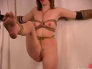 She wants to numb from the agony, but she is ball ball-gagged