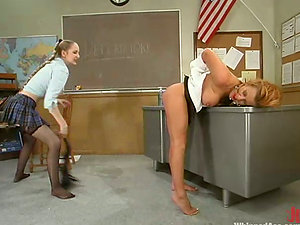 Nice nubile whips and playthings her big-boobed instructor in a classroom