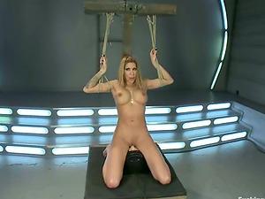 Bosomy blonde Kayla Carrera takes a good rail on a hookup machine
