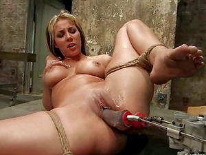Blonde Bombshell Delilah Strong Fucked by Machine in Restrain bondage Vid
