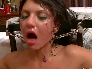 Sultry dark haired woman gets chained and dual penetrated