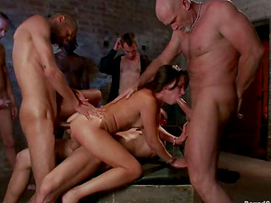 Brown-haired stunner gets tied up and then fucked by horny guys