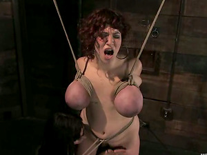 Curly Cougar with big tits gets fisted in restrain bondage flick