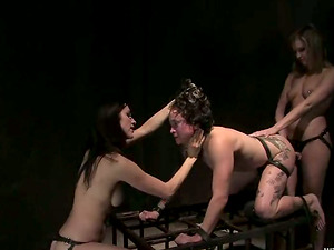 Nasty female gets tormented and fucked by her three girl/girl GFs