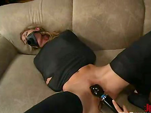 Roxanne Hall gets her vulva toyed by a black-haired domina
