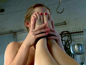 Dani Daniels and Tanya Tate poke their feet into each other's twats