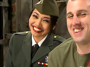 Asian damsel in military uniform spanks a dude and sits on his face