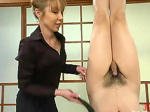 Japanese Lady Spanking a Tied Up Dude Dangling Upside Down