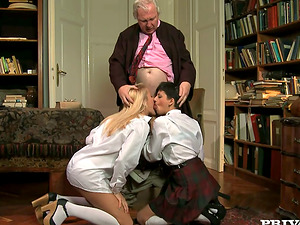 Two nasty students give a suck off to the headmaster